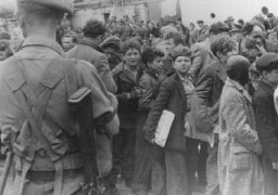 "British soldiers transfer children refugees from the Aliyah Bet (""illegal"" immigration) ship ""Theodor Herzl"" to a vessel for deportation to Cyprus detention camps."