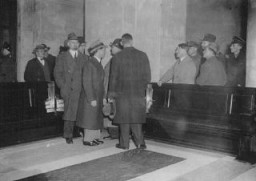 "<p><a href=""/narrative/43/en"">Adolf Hitler</a> (hand on rail) with Hermann Göring (second to left of Hitler) and Joseph Goebbels (third to left of Hitler) at the site of the <a href=""/narrative/11083/en"">fire that damaged the <em>Reichstag</em></a> (German parliament) building. Berlin, Germany, February 1933.</p>"