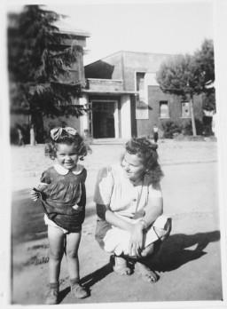 """<p>Ursula Tenenbaum, a Jewish <a href=""""/narrative/5232"""">displaced person</a> (DP), watches her daughter, Katja, in the <a href=""""/narrative/53718"""">Cinecittà</a> DP camp in Italy, June 1945.</p>"""