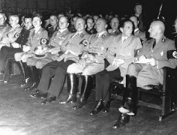 "<p>Nazi district leader of Franconia Julius Streicher (right), propaganda minister Joseph Goebbels (second from right), and other Nazi officials attend the opening of the exhibition <a href=""/narrative/11815/en""><em>Der ewige Jude</em></a> (The Eternal Jew). Munich, Germany, November 8, 1937.</p>"