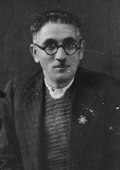 "<p>Joseph Levi, a pharmacist and the head of the Jewish community of Komotine, wearing the compulsory Jewish badge. Bulgarian occupation authorities later deported him to the <a href=""/narrative/3819"">Treblinka killing center</a>. Komotine, Greece, 1942.</p>"