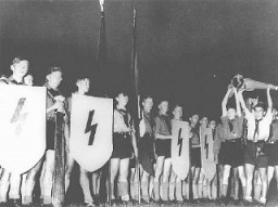 A Hitler Youth ceremony of the sort conceived by Baldur von Schirach—to strengthen dedication to Hitler—in which members recited ... [LCID: 79888]