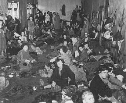 "<p>Romani (Gypsy) survivors in a barracks of the <a href=""/narrative/4549/en"">Bergen-Belsen</a> concentration camp during <a href=""/narrative/2317/en"">liberation</a>. Germany, after April 15, 1945.</p>"