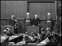 <p>Defendant Julius Streicher is sworn in as a witness during the International Military Tribunal at Nuremberg.</p>
