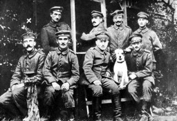 "<p><a href=""/narrative/10864/en"">Adolf Hitler</a> (front row, far left) served on the western front in World War I and during the course of the war was twice decorated for service, wounded, and temporarily blinded in a mustard gas attack. He used his veteran status in later election campaigns.</p>"