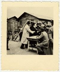 "<p>George Mandel-Mantello greets the Satmar Rebbe, Joel Teitelbaum, upon his arrival in Switzerland on the Kasztner transport from <a href=""/narrative/4549/en"">Bergen-Belsen</a>. Switzerland, December 1944.</p>"
