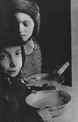 "<p>In the <a href=""/narrative/2014"">Warsaw</a> ghetto, Jewish children with bowls of soup. Warsaw, Poland, ca. 1940.</p>