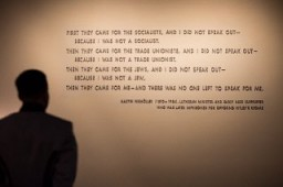 "<p>A visitor stands in front of the <a href=""/narrative/271/en"">quotation</a> from <a href=""/narrative/10764/en"">Martin Niemöller</a> that is on display in the Permanent Exhibition of the United States Holocaust Memorial Museum. Niemöller was a Lutheran minister and early Nazi supporter who was later imprisoned for opposing Hitler's regime.</p>"