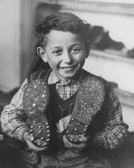 "<p>A Jewish child refugee who fled eastern Europe as part of the organized postwar flight of Jews (the <a href=""/narrative/5217/en"">Brihah</a>). Pictured here as an apprentice at the Selvino children's home for Jewish displaced persons. Italy, October 20, 1946.</p>"