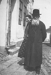Isak Saleschutz and his daughter, Rachel, stand in front of their house.