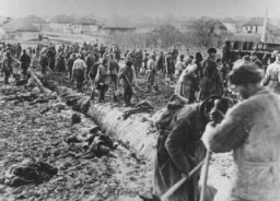 """<p><a href=""""/narrative/10135/en"""">Soviet prisoners of war</a> at forced labor build a road. Probably in the Soviet Union, about 1943.</p>"""