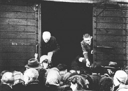 """<p>Jews being deported from the <a href=""""/narrative/2014/en"""">Warsaw</a> ghetto board a freight train. Warsaw, Poland, July-September 1942.</p>"""