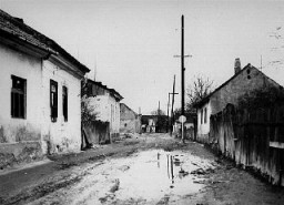 "<p>A deserted street in the area of the <a href=""/narrative/11710/en"">Sighet Marmatiei</a> ghetto. This photograph was taken after the deportation of the ghetto population. Sighet Marmatiei, Hungary, May 1944.</p>"