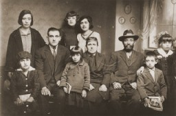 "<p>Portrait of the family of Mushon and Rebeka Kamchi in Bitola. Isak Kamchi is pictured in the front row at the right. Isak was born in Bitola. Several of his siblings and cousins left Macedonia for Palestine and North America before the war. During World War II, Isak served as the leader of a partisan unit operating in Croatia. He established a safehouse at his parent's home in Zagreb where partisans could rest and recuperate. His mother ran the safehouse, cooking for the men and nursing them back to health. When the Germans discovered the safehouse, they offered Isak protection in exchange for his surrender. However, when he did surrender, he was arrested and later killed. He may have been publicly hanged. Photograph taken in <a href=""/narrative/9092/en"">Bitola</a>, ca. 1932.</p>"