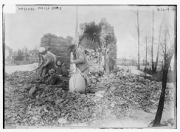 "<p>A man, women and a child sort through the rubble of a Polish home destroyed during <a href=""/narrative/28"">World War I</a>. Photograph taken ca. October 18, 1915.</p>"