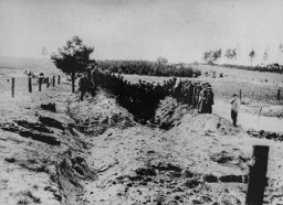 "<p>Soviet officers preside over the opening and exhumation of a mass grave at the Ninth Fort. Photographed by George <a href=""/narrative/11692"">Kadish</a>. Kovno, Lithuania, 1944.</p>"