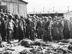 <p>General Dwight D. Eisenhower and other American officers inspect conditions in the Ohrdruf concentration camp shortly after the liberation of the camp. As American forces had approached, SS camp guards shot the remaining prisoners before abandoning the camp. Confirmation of such atrocities prompted the US military to require Nazis and local German civilians to view the camps.</p>
