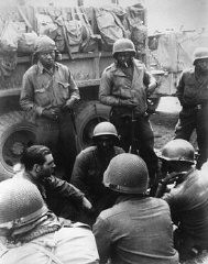 "<p>Members of the <a href=""/narrative/8066/en"">12th Armored Division</a>, which included African American platoons, await their orders. Germany, April 1945.</p>"