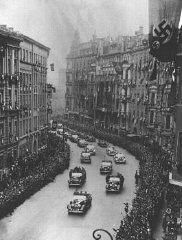 """<p>Scene during <a href=""""/narrative/35294"""">Adolf Hitler</a>'s triumphant return to Berlin shortly after Germany's annexation of <a href=""""/narrative/5815"""">Austria</a> (the Anschluss). Berlin, Germany, March 17, 1938.</p>"""