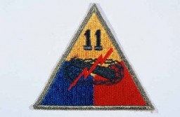 "<p>Insignia of the <a href=""/narrative/7842/en"">11th Armored Division</a>. ""Thunderbolt"" is a nickname adopted by the 11th Armored Division during its rapid march in December 1944 to reinforce US troops defending against the German military offensive in the <a href=""/narrative/8156/en"">Ardennes Forest</a>.</p>"