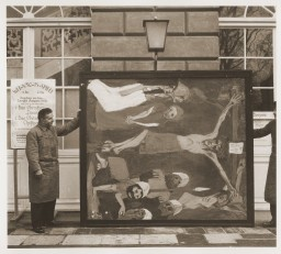 Art handlers hold a confiscated artwork by Emil Nolde
