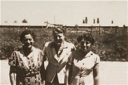 "<p>A woman (right) imprisoned in the <a href=""/narrative/4842/en"">Gurs</a> camp stands with two Quaker delegates who worked for the <a href=""/narrative/4339/en"">American Friends Service Committee</a>. Gurs, France, after January 1941.</p>"