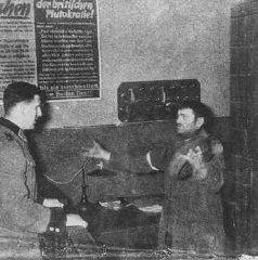 German policeman interrogates a Jewish man accused of smuggling