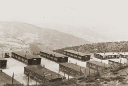 "<p>View of buildings in the <a href=""/narrative/10581/en"">Natzweiler</a> concentration camp. Beginning in the summer of 1943, the Germans detained many <a href=""/narrative/11002/en"">""Night and Fog""</a> prisoners in Natzweiler-Struthof. This photograph was taken following the liberation of the camp. Natzweiler-Struthof, France, 1945.</p>"