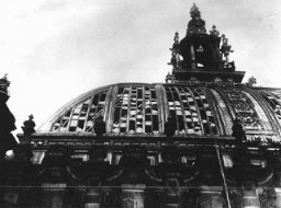 "<p>Dome of the Reichstag (German parliament) building, damaged by <a href=""/narrative/11083"">fire</a> on February 27, 1933. Hitler used the arson to convince President Hindenburg to declare a state of emergency, <a href=""/narrative/11461"">suspending constitutional safeguards</a>. Berlin, Germany, 1933.</p>"