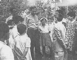 "<p>William Bein, director of the American Jewish <a href=""/narrative/5002/en"">Joint Distribution Committee</a> (JDC) in Poland, with children at the Srodborow home for Jewish children, near Warsaw. The home was financed by the JDC. Srodborow, Poland, 1946.</p>"