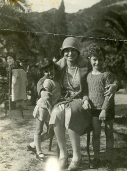 <p>Terese Cohen, a Tunisian Jewish women, poses with her two children, Nadia and Marcel.</p> <p>Immediately after the Allied landings in Algeria and Morocco, the Germans occupied Tunisia. After the occupation, an SS officer came to the Cohen's house and confiscated everything leaving only the table and chairs for the Germans to use. They gave the family 24 hours to pack and leave and then expropriated the home to use as a barracks for soldiers.</p>