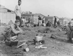"<p>Camp survivors after liberation. <a href=""/narrative/4391"">Dachau</a>, Germany, after April 29, 1945.</p>"