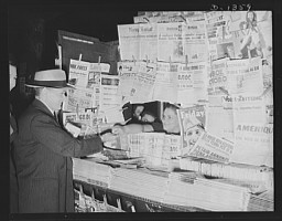 """<p>(1941-1942) Crowded newsstands in the United States such as these held <a href=""""/narrative/32252"""">journals</a> representing various political parties and ideologies. Americans had access to many different perspectives about what was happening at home and abroad during the war.</p>"""