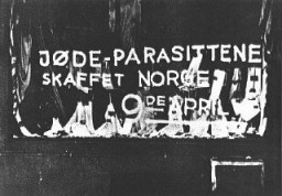 "<p>Antisemitic graffiti on a shop window: ""The Jewish parasite sold Norway on the 9th of April.""  April 9 was the day of the German invasion in 1940. <a href=""/narrative/6313/en"">Norway</a>, ca. 1940.</p>"