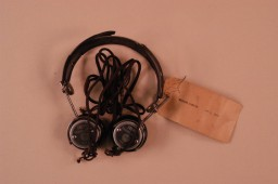 <p>Headphones used by defendant Hermann Göring during the International Military Tribunal. Headphones like these enabled trial participants to hear simultaneous translation of the proceedings.</p>
