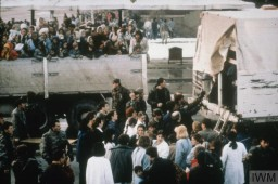<p>Refugee women and children arrive by truck in Tuzla during the Bosnian War, which lasted from 1992 to 1995. They are likely coming from Srebrenica. Photo taken in March 1993.</p>