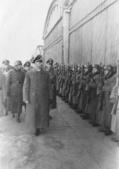 "<p>SS chief <a href=""/narrative/10813/en"">Heinrich Himmler</a> reviews a unit of SS-police in <a href=""/narrative/3055/en"">Krakow</a>, Poland, March 13, 1942.</p>"