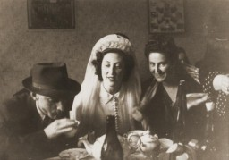 """<p>Photograph taken during the wedding of Ibby Neuman and Max Mandel at the <a href=""""/narrative/11688/en"""">Bad Reichenhall</a> displaced persons' camp. Germany, February 22, 1948.</p>"""