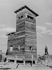 "<p>Ustasa (Croatian fascist) guard next to a watchtower at the <a href=""/narrative/5875"">Jasenovac</a> concentration camp. <a href=""/narrative/6153"">Yugoslavia</a>, between 1941 and 1944.</p>"