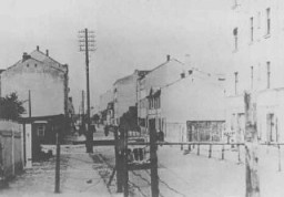 "<p>Entrance to the <a href=""/narrative/6400"">Riga</a> ghetto. Riga, Latvia, 1941–43.</p>