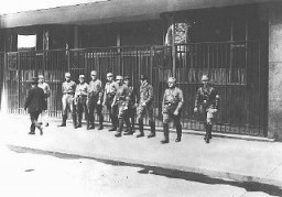 <p>Nazi Storm Troopers (SA) block the entrance to a trade union building that they have occupied. SA detachments occupied union offices nationwide, forcing the dissolution of the unions. Berlin, Germany, May 2, 1933.</p>