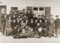 "<p>Group portrait of former Bielski partisans from Nowogrodek taken in the <a href=""/narrative/9339/en"">Foehrenwald</a> displaced persons camp. Germany, April 3, 1948.</p>"