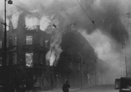 <p>Jewish homes in flames after the Nazis set residential buildings on fire in an effort to force Jews out of hiding during the Warsaw ghetto uprising. Poland, April 19–May 16, 1943.</p>