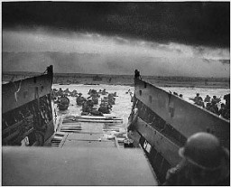 "<p>US troops wade ashore at Normandy on <a href=""/narrative/2899/en"">D-Day</a>, the beginning of the Allied invasion of France to establish a second front against German forces in Europe. Normandy, France, June 6, 1944.</p>"