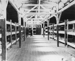 "<p>Barracks for prisoners at the <a href=""/narrative/6783/en"">Flossenbürg</a> concentration camp, seen here after liberation of the camp by US forces. Flossenbürg, Germany, May 5, 1945.</p>"