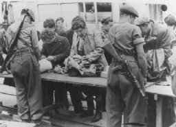 "<p>British soldiers check Jewish refugees from <a href=""/narrative/7475/en"">Aliyah Bet</a> (""illegal"" immigration) ship <em> Theodor Herzl</em>  before deporting them to <a href=""/narrative/26091/en"">detention camps in Cyprus</a>. Haifa port, Palestine, April 24, 1947.</p>"