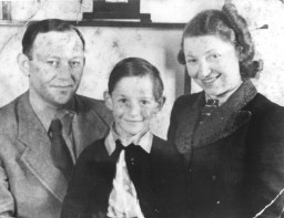 """<p>Michael Fink and his parents Manfred and Herta in the <a href=""""/narrative/4469"""">Westerbork</a> camp, 1941–1944. Westerbork's primary role was as a transit camp. However, there was also a long-term camp population there. The Finks were among these residents. The family was in Westerbork until the spring of 1944, when they were deported to <a href=""""/narrative/5386"""">Theresienstadt</a>. Michael and Herta survived, but Manfred was killed after being deported to <a href=""""/narrative/3673"""">Auschwitz-Birkenau</a> and other concentration camps.</p>"""
