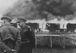"<p>Buildings of the <a href=""/narrative/8176"">Bergen-Belsen</a> concentration camp are burned to the ground by British soldiers to prevent the spread of typhus. Germany, May 21, 1945.</p>"