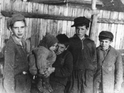 "<p>A group of children in the <a href=""/narrative/3182"">Kovno</a> ghetto in <a href=""/narrative/5762"">Lithuania</a>. This photograph was taken by <a href=""/narrative/11692"">George Kadish</a> between 1941 and 1943.</p>"