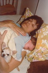 <p>Blanka relaxes with her granddaughter, Alexis Danielle, and a family dog.</p>